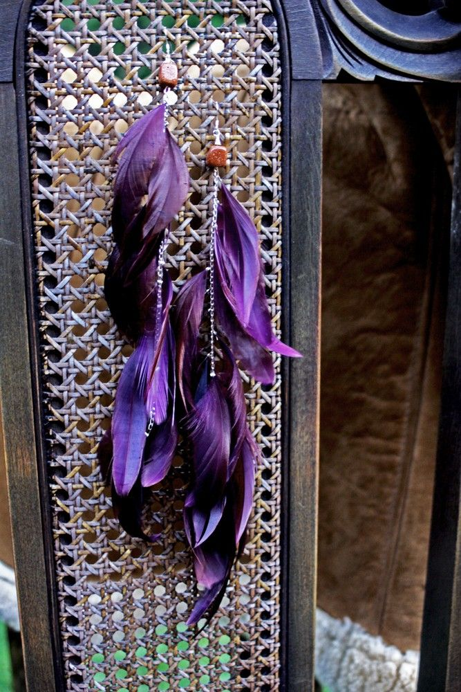 dramatic dark purple feather earrings black swan edition. $40.00, via Etsy.