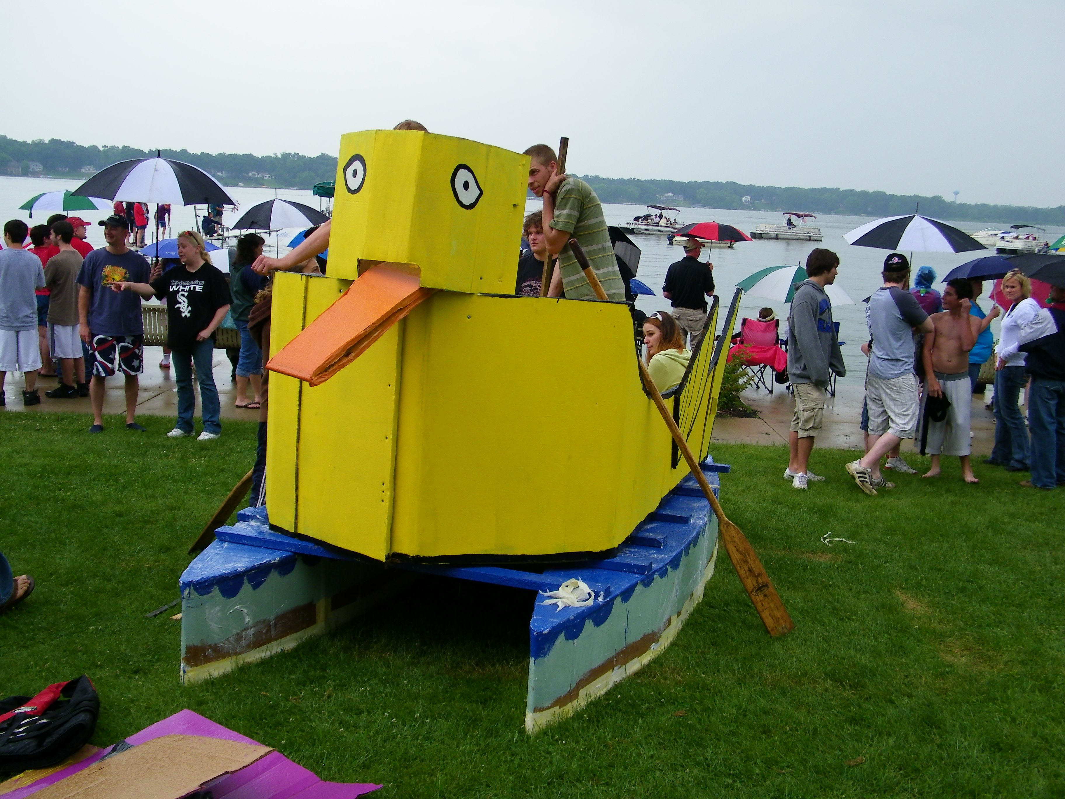 The Great Cedar Lake Cardboard Boat Race Held Yearly At Summerfest Over