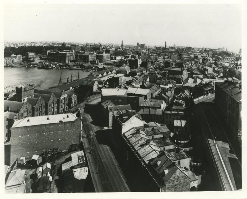 9-15 Atherden Street (now a thoroughfare where Playfair Street meets Atherden Street) | Built 1850s, demolished 1930s | View from George St North looking SE across Circular Quay part of panorama - St Majors Row foreground with Atherden Terraces just above
