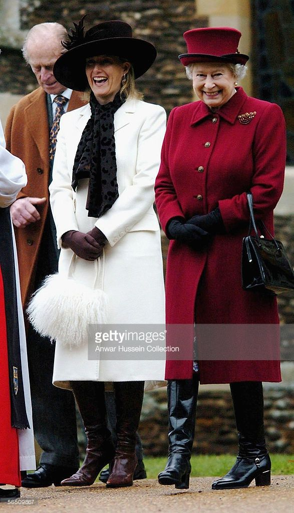 Britain's Queen <a gi-track='captionPersonalityLinkClicked' href=/galleries/search?phrase=Elizabeth+II&family=editorial&specificpeople=67226 ng-click='$event.stopPropagation()'>Elizabeth II</a>, smiles as she leaves St Mary Magdalene Church, alongside Sophie, Countess of Wessex and the Duke of Edinburgh on January 1, 2006, at Sandringham, England.