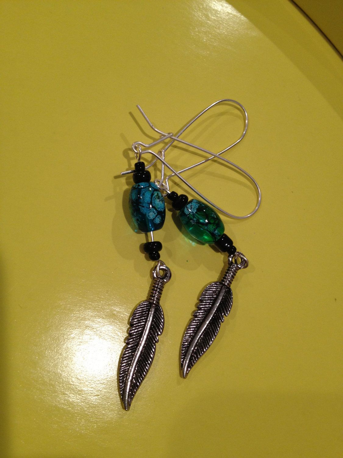 Feather turqoise earrings. $10.00, via Etsy.