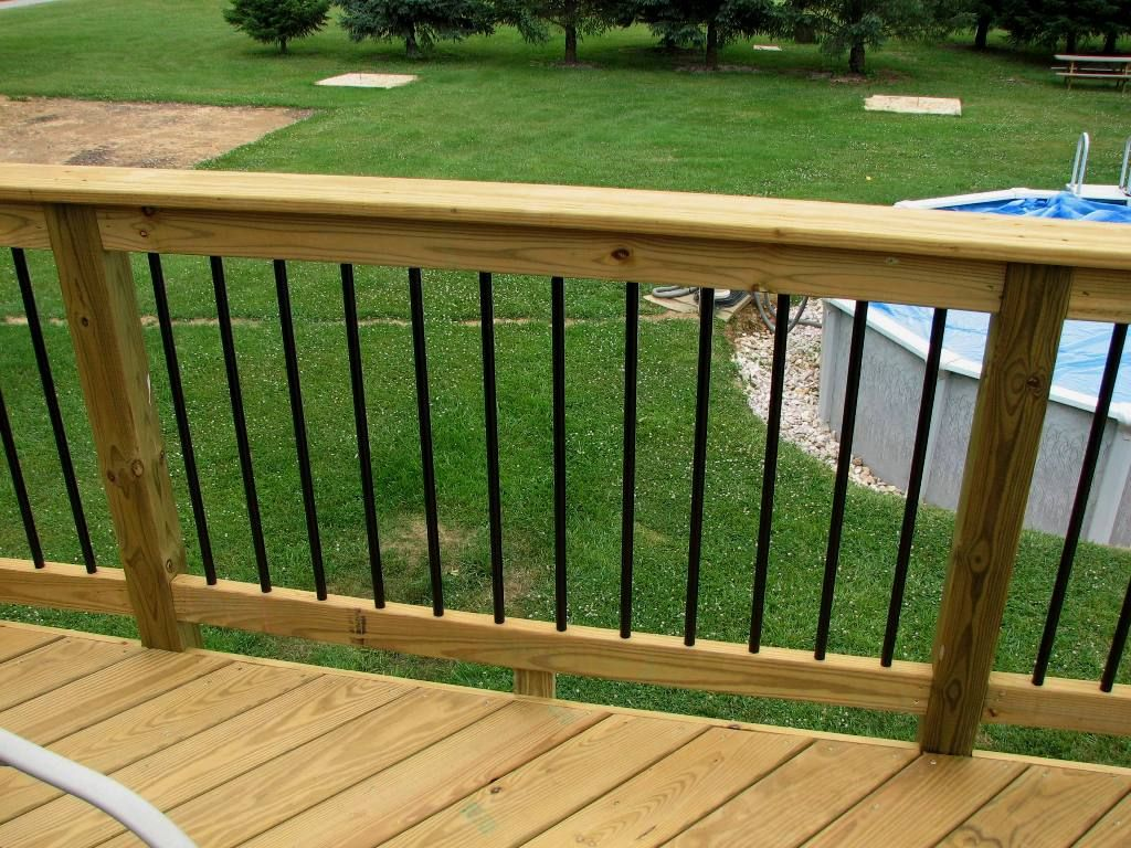 How to install a deck railing -  Deckorators Railing And Accessories Black Aluminum Balusters And Acq Pressure Treated Pine Wood Deck
