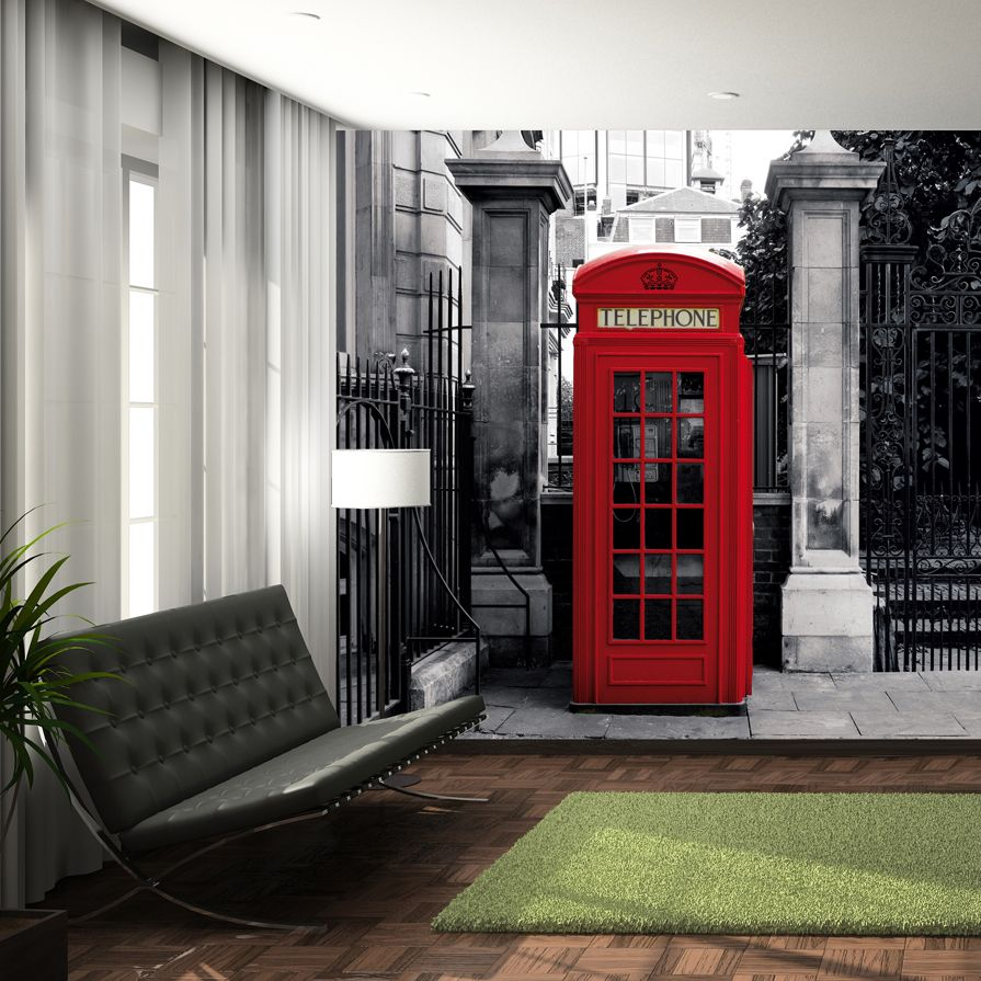 This striking telephone box mural, really keeps us in