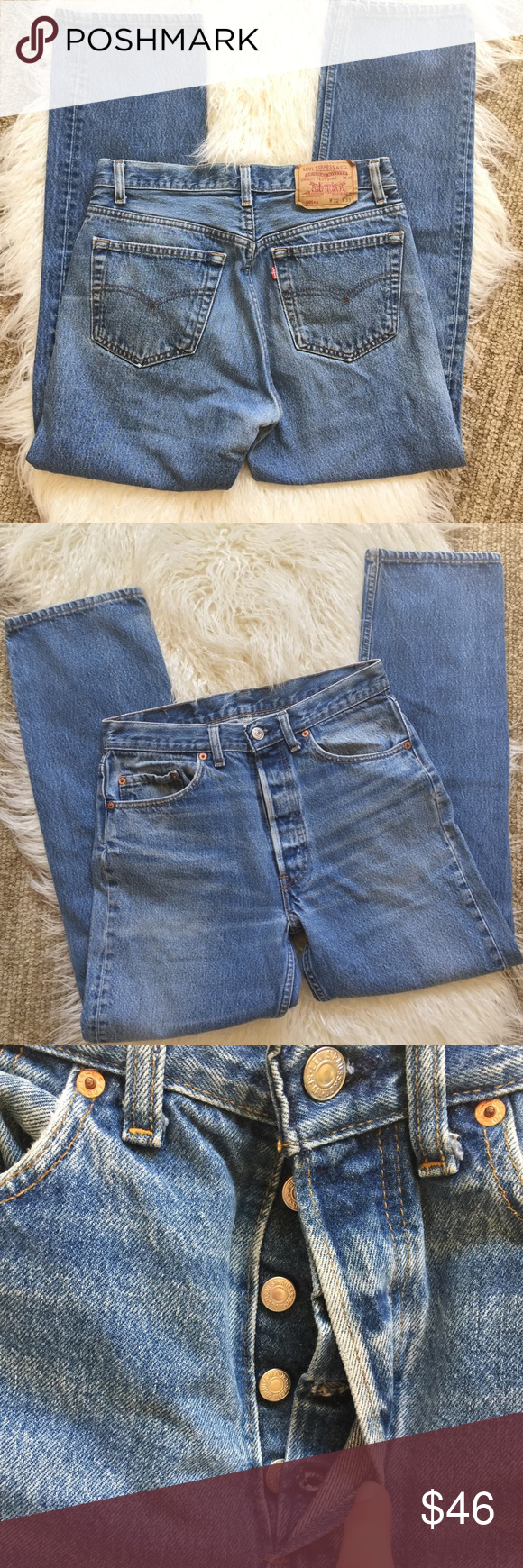 """Levi's 501 vintage button fly high waisted jeans Levi's light wash button fly jeans.  High waist, straight cut.  Levi's patch and label in the back.  Size 32 waist, 33"""" length.   My measurements 29"""" waist, 38"""" length, 29"""" inseam, 11"""" front rise, 34"""" hips, 7"""" leg opening. Good used condition. Small amount of wear in the crotch and bottom of legs Levi's Jeans Boot Cut"""