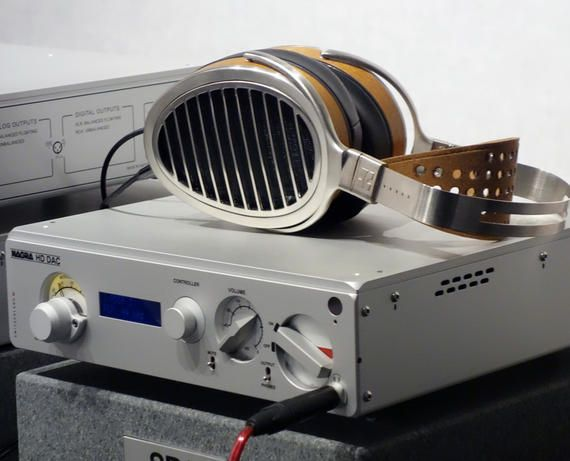 The Nagra HD DAC, shown with Hifiman HE1000 headphones . The HD DAC handles digital files with up to 384-kHz/24 bit, and DSD x 2 resolution. The connectivity suite covers all the bases: digital inputs include two RCA coaxials, two XLRs, one optical, one Nagra 12S, and one USB digital; analog outputs include a 6.3mm headphone jack, RCA and XLR stereo pairs. HD DAC is a bit smaller than most home components, it's 12.2 by 13.7 by 3 inches (277 by 350 by 76mm).