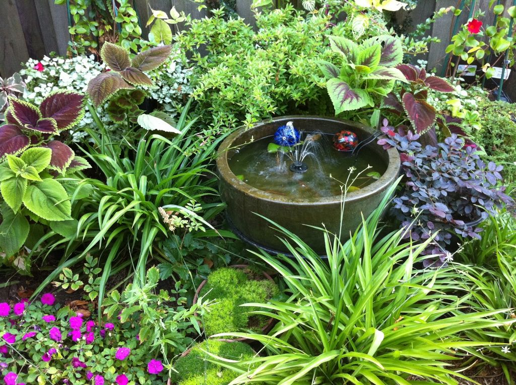 Perfect combination for a shady nook lush perenials for Water feature ideas for small gardens