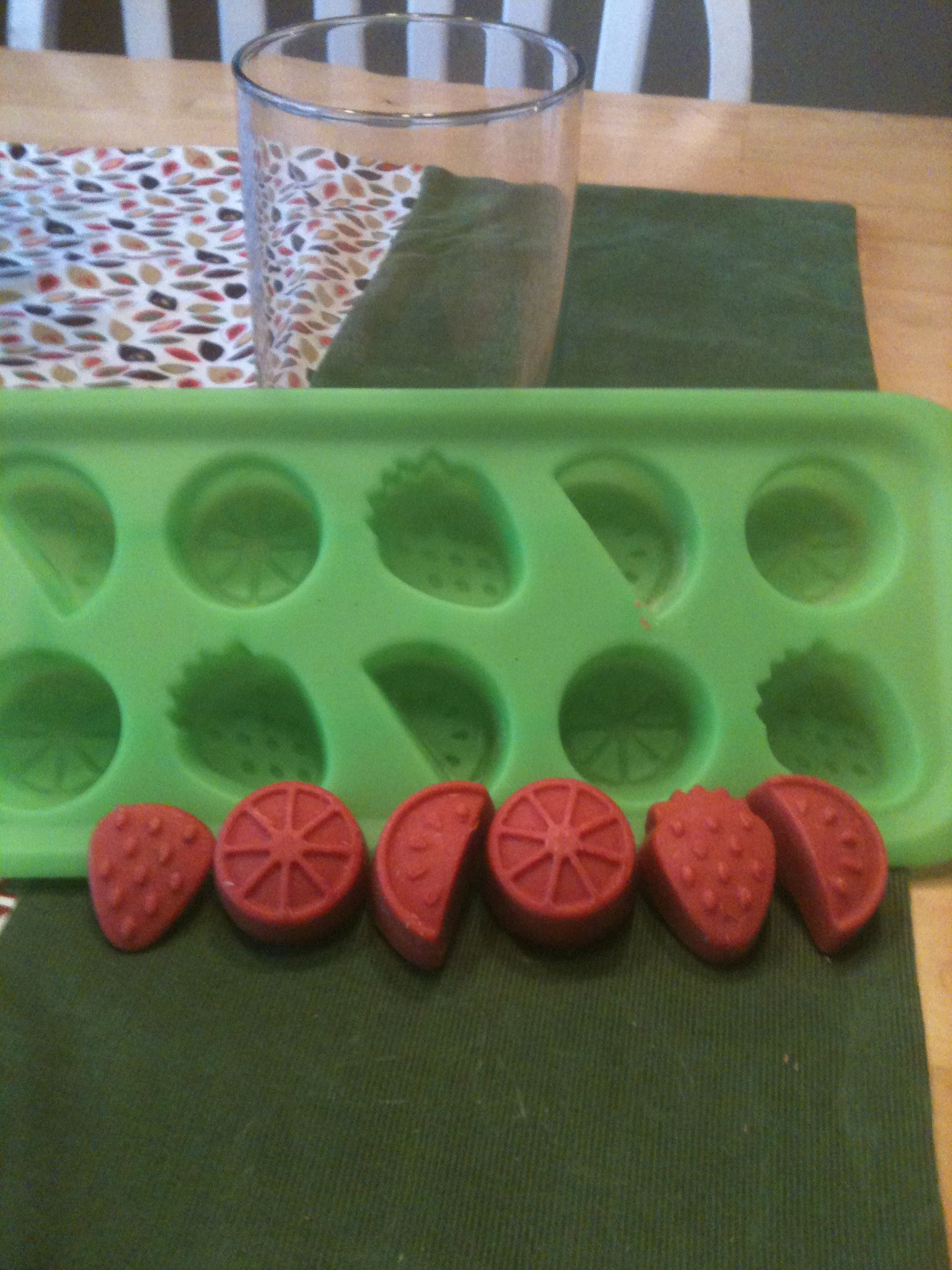 Pour your melted candle wax into silicone ice cube trays. When they harden, pop them out to reuse in Scentsy or other wax melt  warmers. I used what was left of a Yankee candle Perfect Pillar, and now I have the candle holder to reuse!