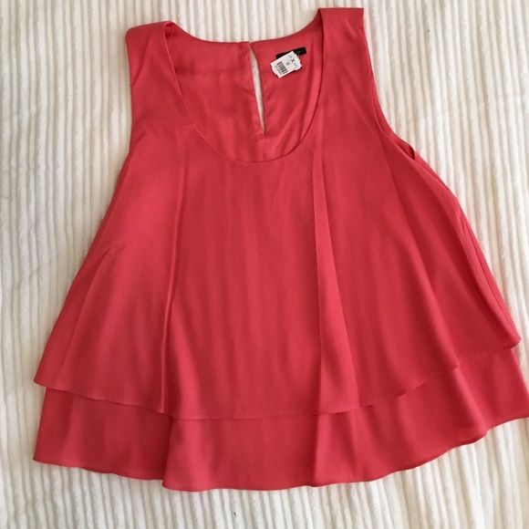Coral pink layered bottom Ann Taylor tank Coral pink layered bottom Ann Taylor tank. Has a cute button on back (shown in picture). Wore once! Ann Taylor Tops Tank Tops