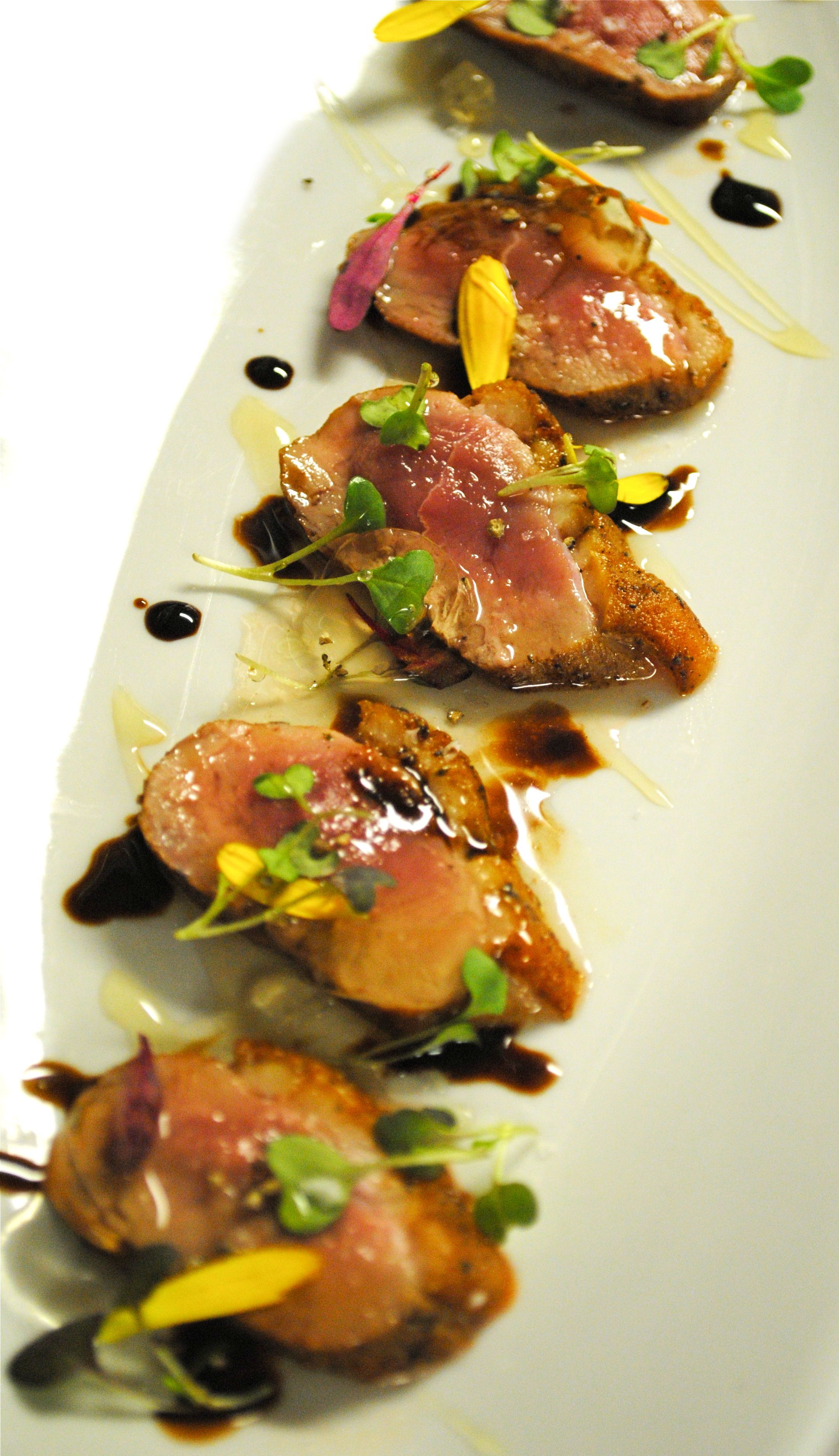 Seared Duck breast lavender tops scented Muscat de Beaums gel wildflower  honey micro greens Balsamic