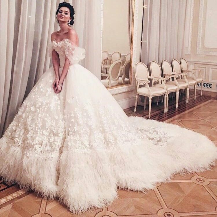 Ivory Tulle Wedding Ball Gown Heavily Embellished With Appliqued Flowers And About 20 Border Of Ball Gowns Wedding Bridal Dresses Wedding Dress With Feathers