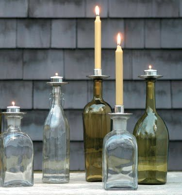 We used candles in some of our bottles like this picture does. We did not have the silver tops though, we just shaved the ends a little to shove the candles in the bottles. We only used long taper candles, not tea lights.