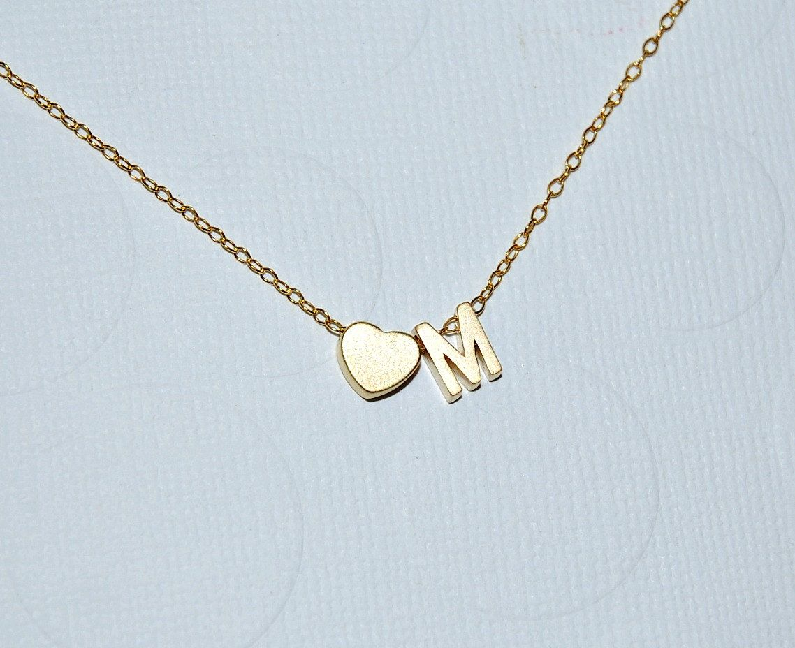 Tiny initial necklace in gold or silver - double - $31.00, via Etsy.
