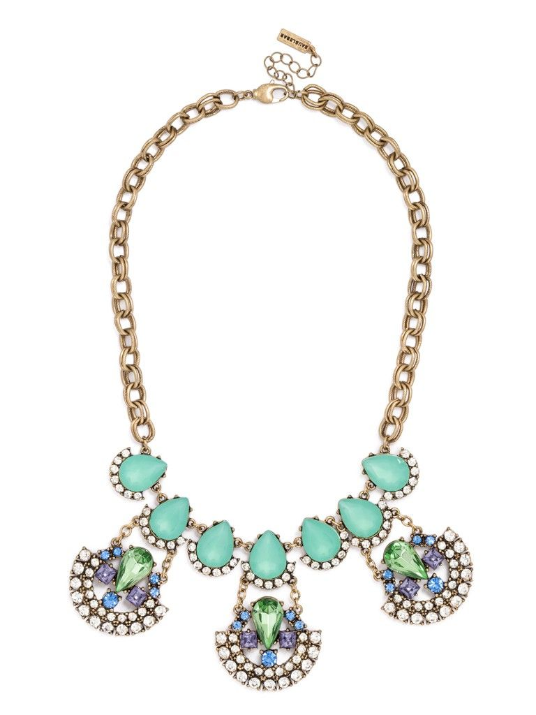 A strand of pastel teardrops hosts aerodynamic, crystal arcs embellished with colored gems for a slightly sporty statement necklace.