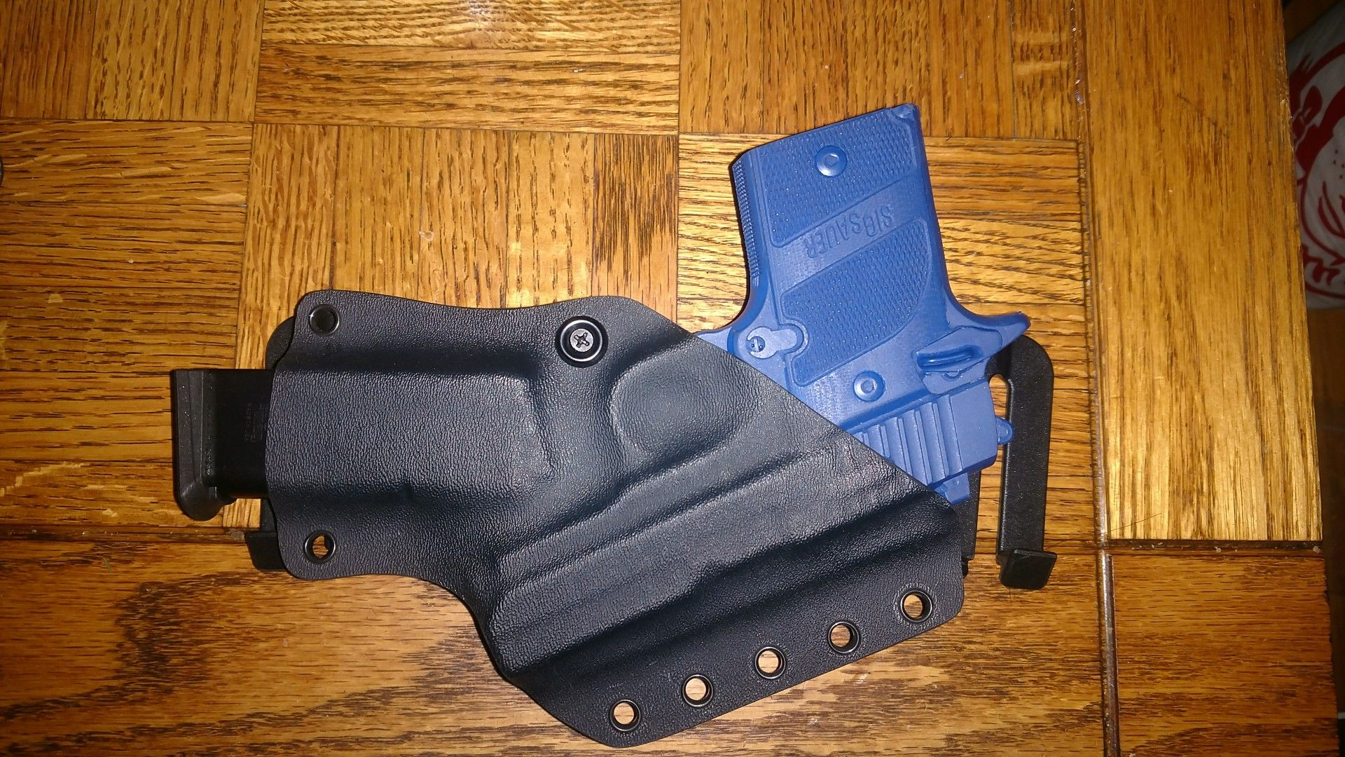 Custom Kydex Small Of Back holster with magazine pouch for