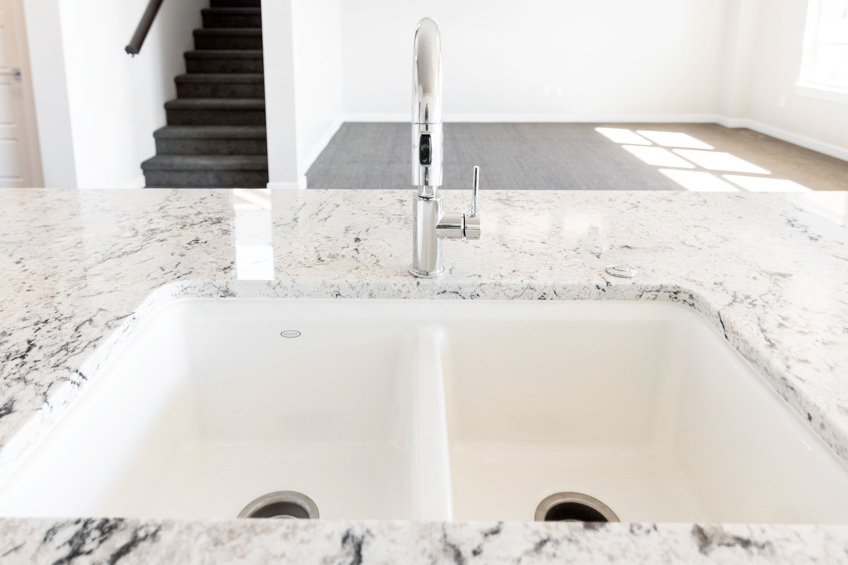 Undermounted White Cast Iron Kitchen Sink With Granite Countertops