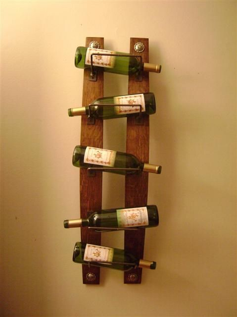 The bottles are slightly slanted as they are placed on an - Wine bottle storage angle ...