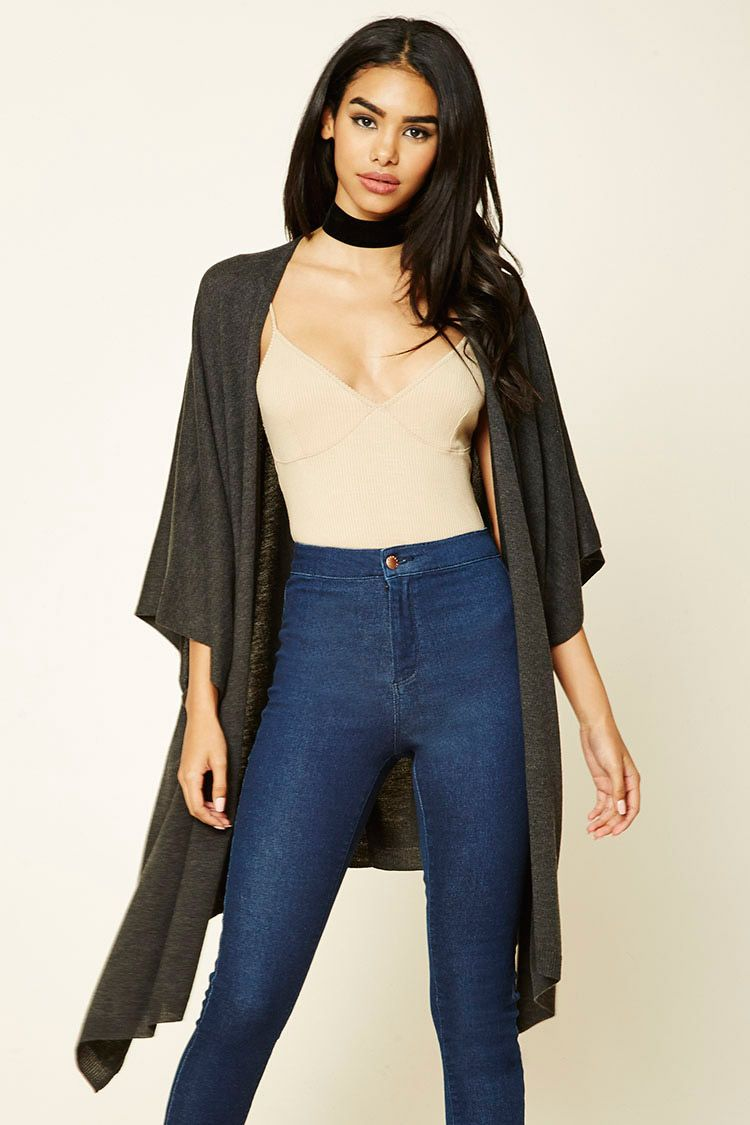 A knit longline cardigan featuring short batwing sleeves, slit ...