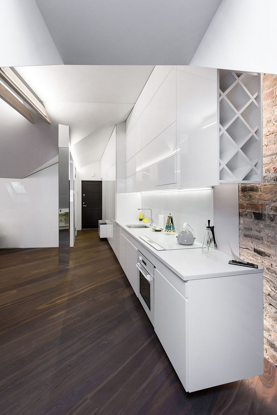 Sleek kitchen workdstation in white makes smart use of space