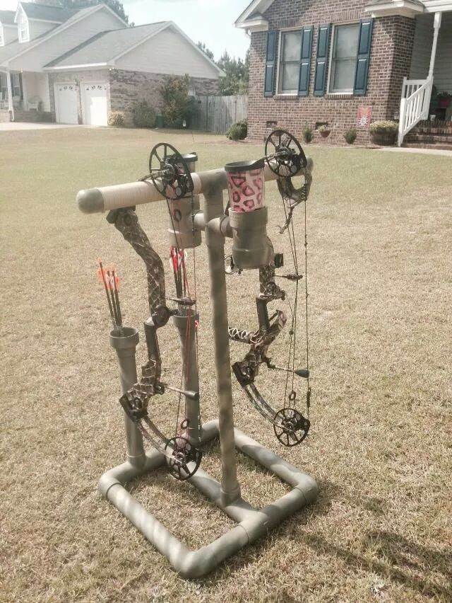My new camouflage double bow stand that i built with the for Pvc pipe bow plans