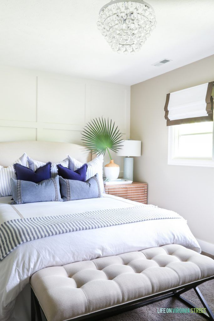 A Coastal Bedroom With White Bedding Blue And White Throw Pillows Gorgeous White Bedding With Decorative Pillows