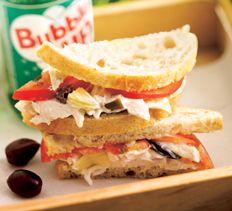 Mediterranean Chicken Salad Sandwich. Garlicky yogurt mayo, artichoke hearts, olives, rotisserie chicken.