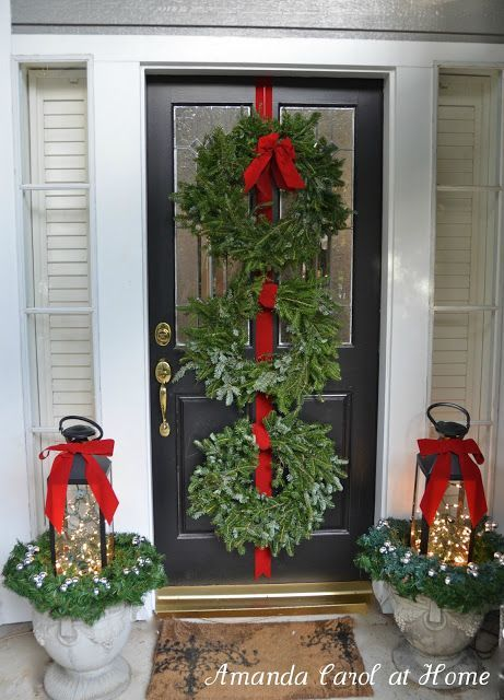 Front Porch Christmas Decor 3 wreaths hung on door, lanterns filled
