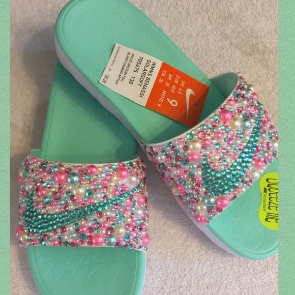 Shop Women s Nike size Various Sandals at a discounted price at Poshmark.  Description  Nike slides blinged out with Faux Pearls and Resin Rhinestones. 381867ff4