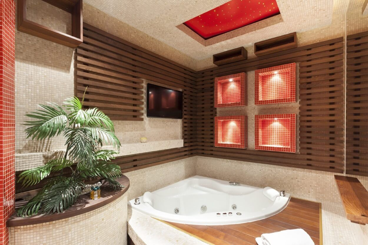 Corner Soaking Tub With Jets And Wooden Platform | Renovate Your ...