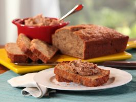 "Banana Bread with Vanilla Bean ""Pecan Butter"" : Simple to make and laced with the fragrant warmth of ground cinnamon, Bobby's moist banana bread is best served warm with a hefty smear of flavored butter, which Bobby doctors up with chopped pecans and vanilla beans."