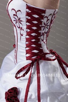 Red corset wedding dress... I kind of love it, reminds me of Snow ...