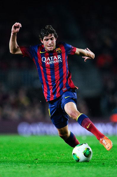 Sergio Roberto of FC Barcelona runs with the ball during the Copa del Rey round of 16 first leg match between FC Barcelona and Getafe CF at Camp Nou on January 8, 2014 in Barcelona, Catalonia.