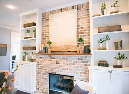 Built In Shelves Around Brick Fireplace