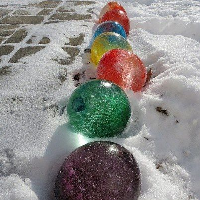 In wintry temperatures, fill balloons with water and food colouring. When the water has frozen, remove the balloon and you have giant marbles!