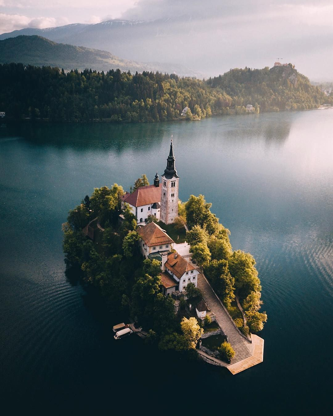A Stunning Shot Of Bled Island Which Sits Within Lake Bled The Island Has Several Buildings The Main One Being The Pilgr Lake Bled Instagram Places To Travel Beautiful photo church on bled island