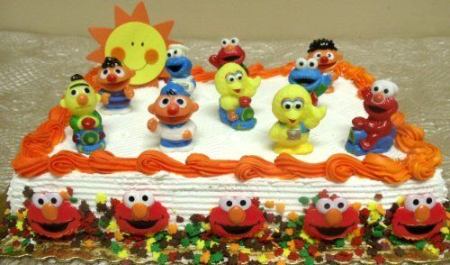 17 Piece Sesame Street Birthday Cake Topper Set Featuring 2 Sesame Street Figures Big Bird, Elmo, Cookie Monster, Ernie, Bert, Decorative Sun Symbol by Sesame Street, http://www.amazon.com/dp/B005RKF11G/ref=cm_sw_r_pi_dp_wKmNrb0M32508
