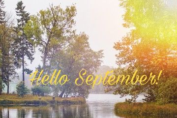 Hello September banner. New month. Greeting card. Golden autumn. The text in the photo. Trees in the park. City Park. Autumn Park #helloseptember
