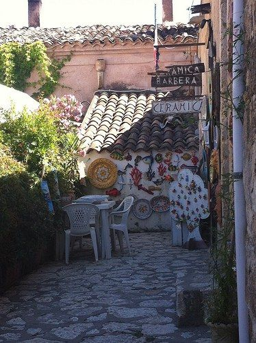 Scopello, a charming village in Sicily with sparkling blue sea and colourful craft shops still surrounded by the ancient village walls. A stop you can't miss if touring Sicily and a destination to add to your Italy bucket list