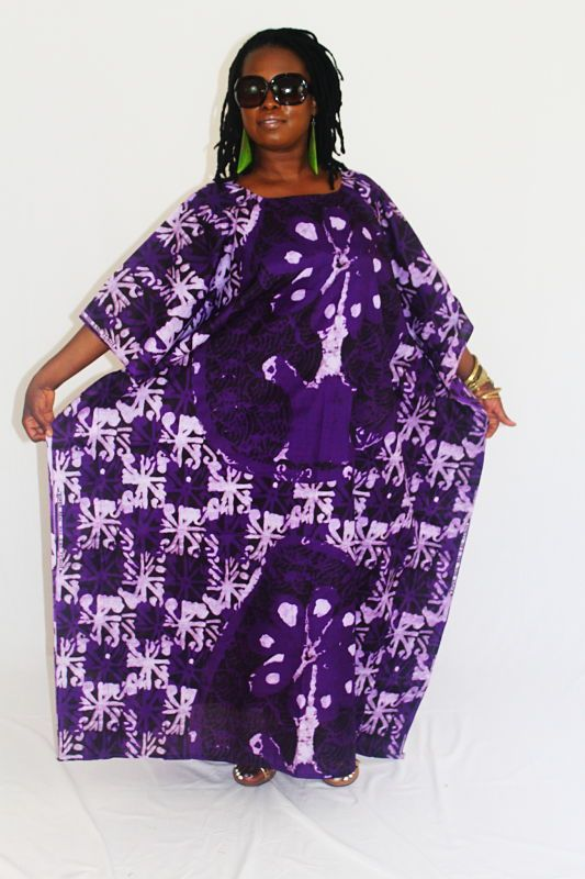 "White and purple starbursts on popular DaViva wax print cloth; approximate measurements - outer width 37"", inner stitching fits up to 52"" all around; length 51""  $38.95"
