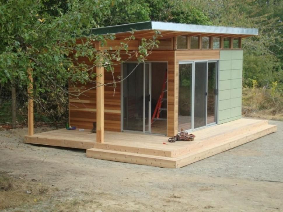 Exterior flat roof and retractable door on modern shed for Shed roof house designs modern