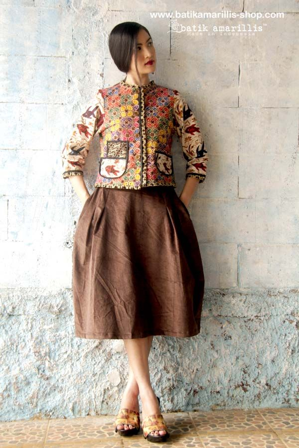 batik amarillis's parisian walkways jacket www.batikamarilli... .. add polish to your tailored wardrobe! such fitted and chic jacket with quirky twist! accented with panelled detailing & contrast trims plus 3 quirky pockets! in such lovely batik Banyumas of Indonesia
