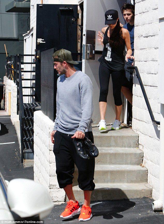 David and Victoria Beckham take eldest son Brooklyn to ...