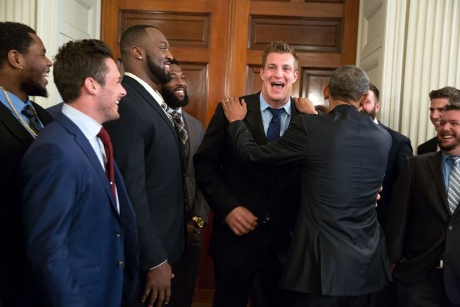 President Barack Obama Jokes With Tight End Rob Gronkowski As He Greets The New England Patriots In State Dining Room Prior To An Event Honor