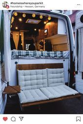 Photo of adorable camper van with folding cushioned sofa and side tables out the back #Ad…
