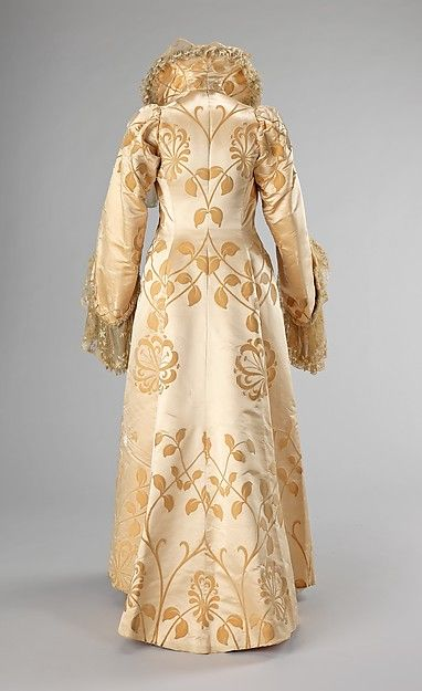 Gorgeous House of Worth creation -- look at that attention to detail (design and fabrication) of this wonderful Evening coat Design House: House of Worth (French, 1858–1956) Designer: Jean-Philippe Worth (French, 1856–1926) Date: ca. 1902 Culture: French Medium: silk Dimensions: Length at CB: 63 in. (160 cm) Credit Line: Brooklyn Museum Costume Collection at The Metropolitan Museum of Art, Gift of the Brooklyn Museum, 2009; Gift of Mrs. C. Oliver Iselin, 1961