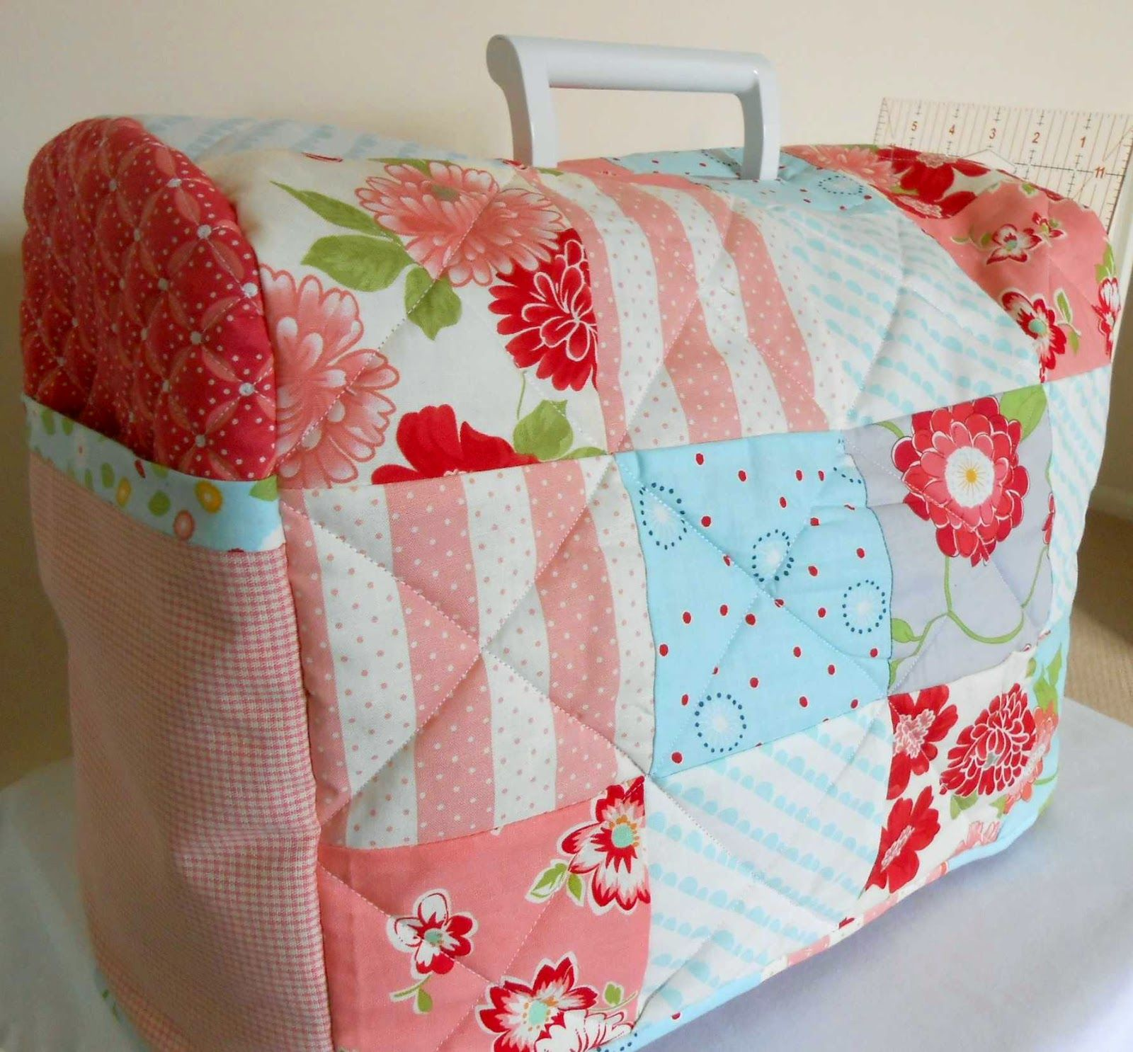 My new patchwork sewing machine cosy complete with end pockets the patchsmith across the pond sewing machine cover tutorialfree pattern original pdf for bernina this is adapted for husqvarna jeuxipadfo Choice Image