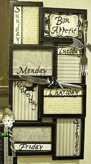 My new Menu board.  A cheap picture frame, scrapbook paper, cheap flatware, lots of Bling  and a dry erase marker!