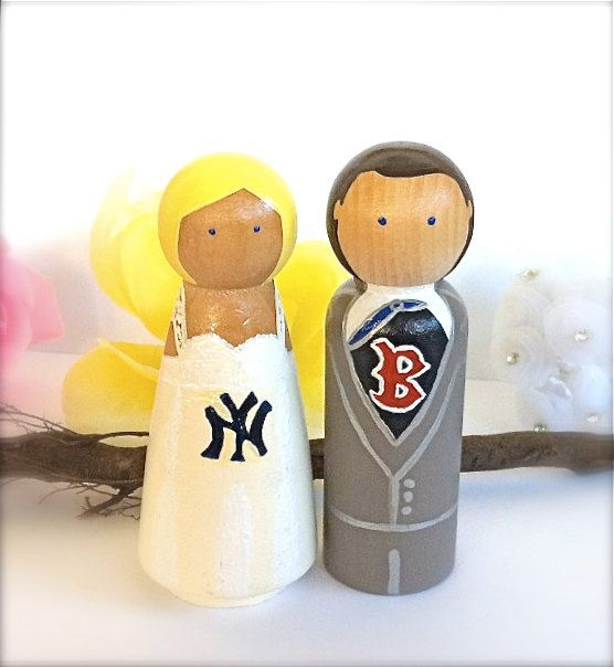 cake toppers...these are cute(if only they were both Yankees)