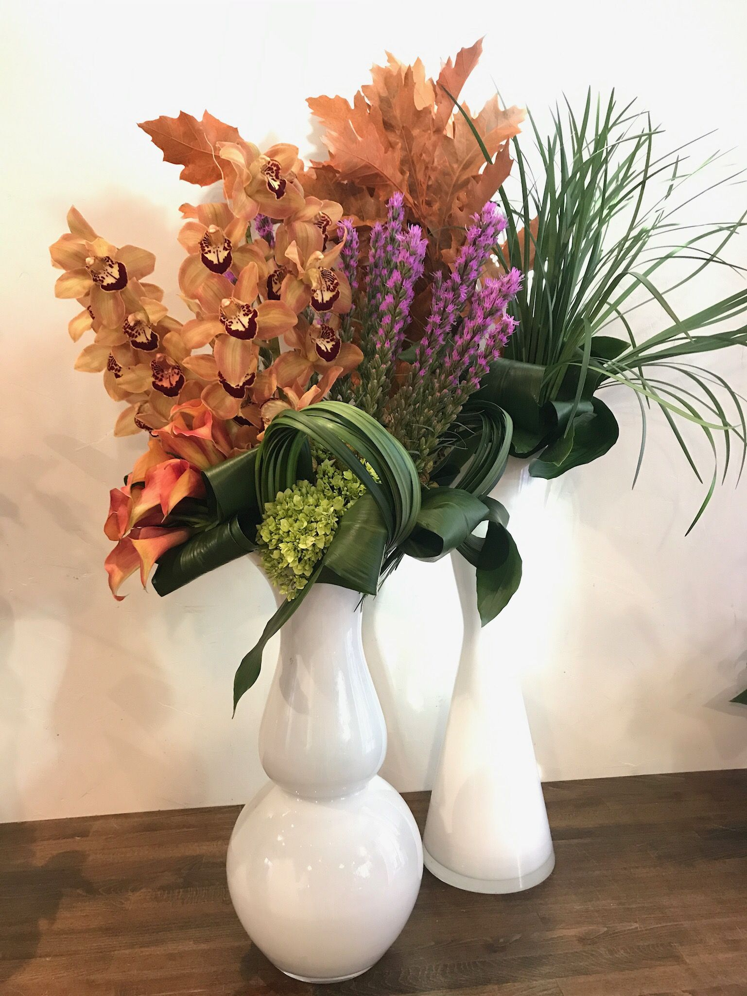 Cymbidium Orchids Liatris Oak Leaves Calla Lilies And Grasses Fill Out These Arrangements Corporate Flowers Flower Subscription Cymbidium Orchids
