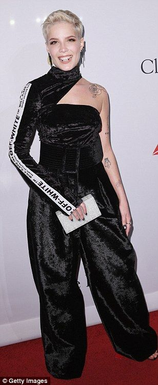 All smiles: Halsey grins broadly in an interesting turtleneck, one-sleeve velour jumpsuit