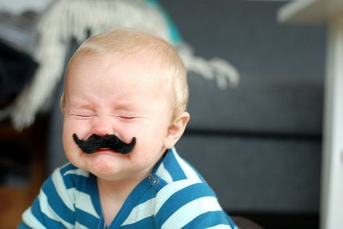 Image result for baby with mustache in womb gif